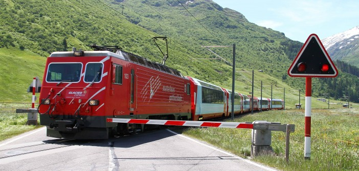 Petri Net-Based Validation of New Safety Requirements of the CSM Regulation in relation to Standardised Level Crossings in Switzerland